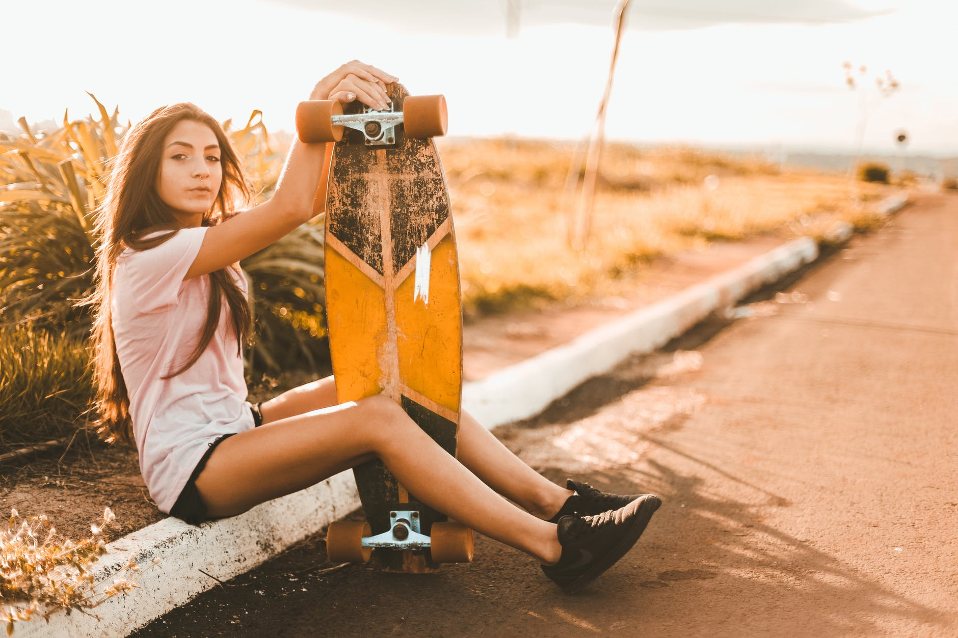 skater with her longboard and best grip tape