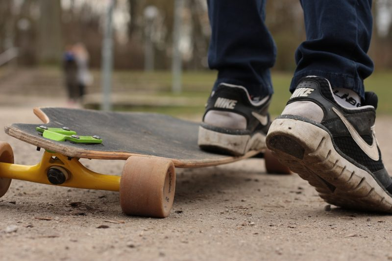 Person standing on a longboard