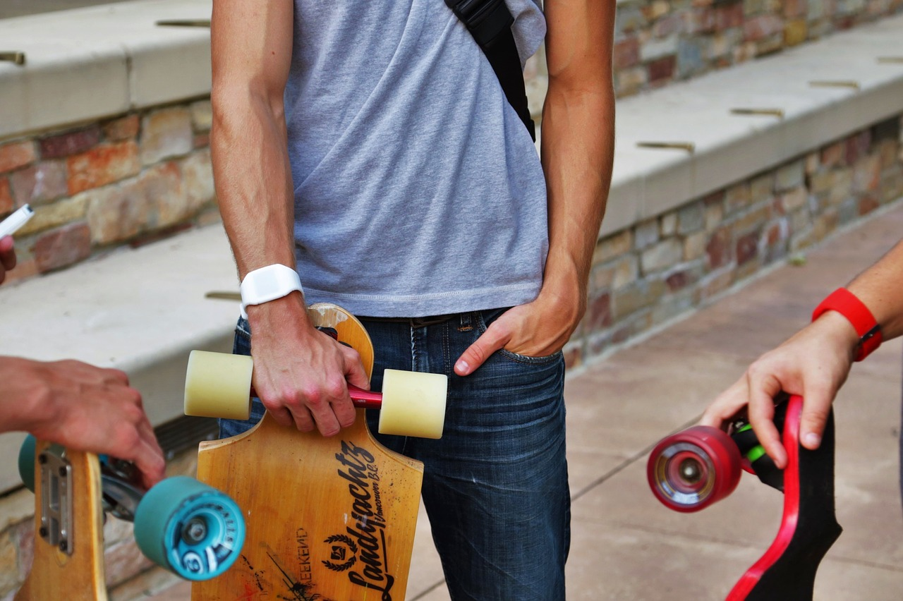 People holding longboards
