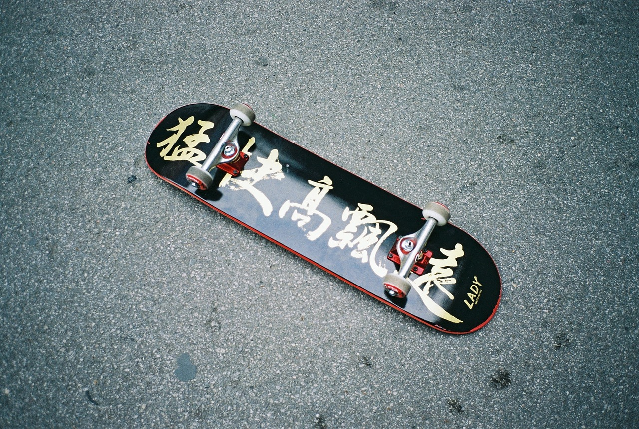 black skateboard with chinese letters written